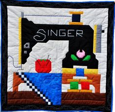 Appliqued and Pieced. Sewing machine quilt top pattern. Have to make this quilt to hang in my sewing room.  So cute. I will have to put it above my Vintage Singer  Sewing Machine looks just like it.  Nice.