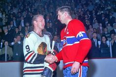 Jean Beliveau accepts congratulations from Bobby Hull following the 1965 Stanley Cup Final.