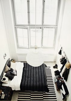 Love the shape of this space and the mixed b/w patterns