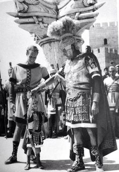 Actor Charlton Heston always got a miniature costume made for his son modeled after roles in movies he was currently filming. Here is a snapshot of Charlton Heston, his son, and Jack Hawkins from 1959 on the set of Ben-Hur.