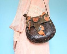 Vintage tooled leather Western handbag with miniature saddle on top. Rough out, brown and natural tanned leather construction. Faux shearling lining. Appears to be handmade. Distressed vintage condition with lots of character. Western Purses, Vintage Tools, Dry Goods, Leather Tooling, Bucket Bag, Westerns, Brown, Mini, Model
