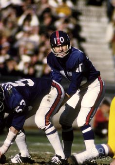 New York Giants quarterback Fran Tarkenton (10) at the line of scrimmage against the San Diego Chargers at Yankee Stadium. The Giants defeated the Chargers 35-17.
