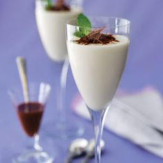 White Chocolate Panna Cotta With Dark Chocolate Sauce    Served in stemmed glasses, these silky smooth Italian custards make an elegant ending to any meal.