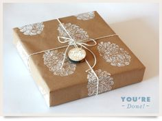 Lino Block or potato print a design on brown paper. Tie with a cord and an interesting name tab.