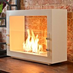 Super cool, a portable fireplace for indoors or outdoors.a little on the modern side for my usual tastes, but it's such an awesome idea! Portable Fireplace, Outdoor Fireplace Designs, Outdoor Fireplaces, Ethanol Fireplace, Fireplace Screens, Moraira, Apartment Design, Sweet Home, New Homes
