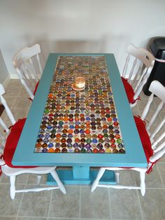 Our Kitchen Table, bottle caps covered in glass, recycled chairs and old desk