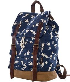 "* Floral backpack with PU trim * Double shoulder straps with short handle. * Interior zip, wall and cell phone pockets * Inside lining with zipper pocket * Exterior pocket. * Dimensions: 12""(L) x 7""(W"