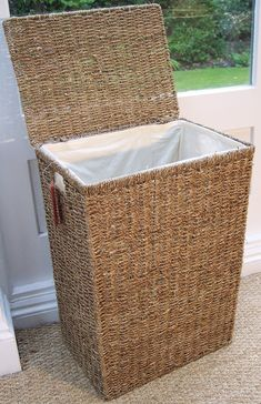 Sea Grass linen laundry basket with lid. Hand woven, measures 59  centimeters wide,