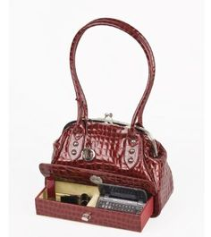 On first glance, you would not suspect that a bag like this can actually come with a compact drawer.    Like so…    Released last year by Liz Couture, this satchel is made of croc-embossed patent l