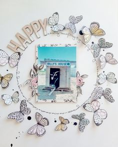 Single page ~ one vertical photo; penned circle; butterflies