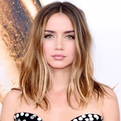 The Prettiest Blonde Highlights for Brunette Hair - Ana de Armas from InStyle.com