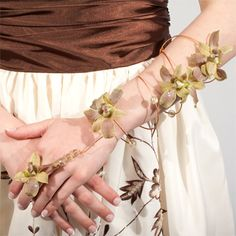 """""""Juliet,"""" a romantic twining wire armband for prom with dendrobium orchid blooms and beads. #VivianoFlowerShop #homecoming"""