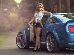 posing with car, only with wayyyyy more clothes on...