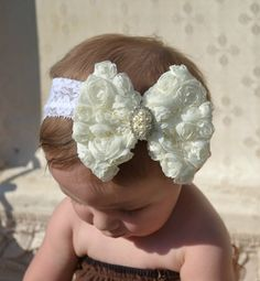 ivory baby bow headband by CutiePatootyz. I'd like just a round instead of a bow with the sparkley in the middle