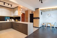 HDB 4-Room Standard Flat, 93 sqm. Highlight of the house is the open kitchen concept, which gives a spacious feel to the 4 room HDB. The classic floral titles at the entrance adds a contrasting loo…