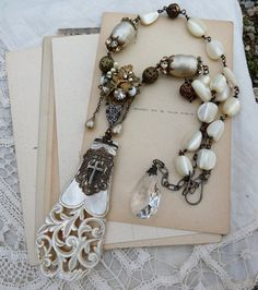 Vintage Assemblage Mother of Pearl Necklace, Joan of Arc, The Hilt of Sainte Jeanne's Sword, by RusticGypsyCreations.  via Etsy.