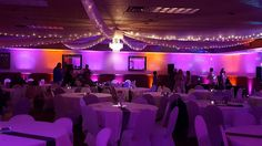 Wedding Lighting in the Proctor Blackwood's banquet center. Up lighting in magenta pink and orange. Ceiling by Occasions. © 2016 All rights reserved. Duluth Event Lighting www.dulutheventlighting.com