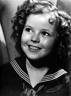 Pecola think this is beauty because Shirley Temple has blue eyes and she is white with curly hair.