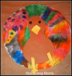 Thanksgiving Craft :: Coffee Filter Turkey. Our kiddos love this and we use a cutout of their footprint for the body!