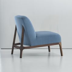 The Claire lounge chair is simultaneously simple and complex. The simplicity of its universal form allows it to be paired comfortably with many different styles of furniture. The hand carved wood frame is a continuous loop that subtly changes angles and shapes as it moves around the chair. The canted back legs are seamlessly integrated into the upholstered back and give the design a sleekness and sense of motion. The unadorned seat and back provide a blank canvas for designers to select a…