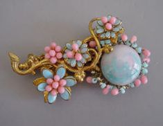 HASKELL  pink and  blue glass bead, pink glass bead and blue enamel set in gold tone brooch,  3.