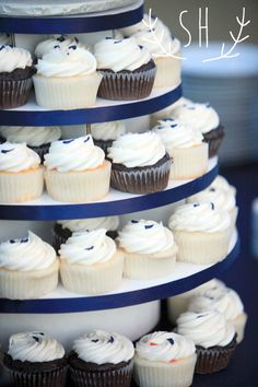 cupcake tower, blue and white theme, bicycle topper  Wedding Cake   Sarah Hummert Photography www.sarahhummertphoto.com