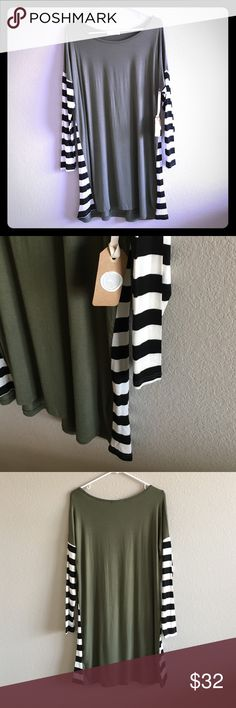 Striped Sleeve Comfy and Modest Dress Gorgeous, comfy and fun! This dress is 96% rayon and 4% spandex. Made in the USA. Olive dress with black and white striped sleeves and side stripe detail. 34.5 inches from shoulder top to bottom hem. VMR Clothing Dresses
