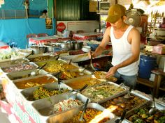 Photo of the Day – Thai Curry at the Local Market – Ko Samui, Thailand    Thailand has some of the best food in the world. The amazing flavor and spice in the seemingly endless curry dishes can make our normal American fare taste rather bland.    When you first visit Thailand you might find yourself initially shocked by how mild the curry tastes. This is because all of restaurants frequented by tourists have toned down the spice in their dishes to cater to the typical tourist taste  ...