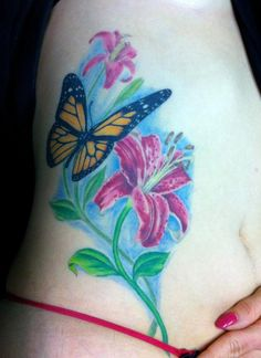 Butterfly, lily tattoo...  #tattoos #butterfly #flower #tattooforwomen #colorful #Lily