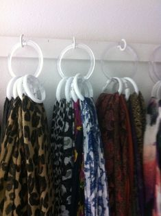 Found a way to organize scarves in a limited space. I used cup hooks, plastic rings some scarves come on and inexpensive dollar store shower curtain rings.
