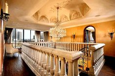 Traditional Staircase with Metal staircase, Hardwood floors, Stone Baluster System, Chandelier, High ceiling, Paint1