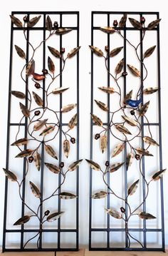 These panels are designed as infills for a front door.  Featuring marri eucalyptus in a natural wreath formation and a boy and girl blue wren on each panel looking at each other.  Jalmer Iron specialises in unique iron doors, made from recycled steel.  Get something special for your home or business that will get your visitors talking.
