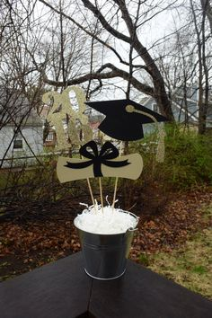 Graduation Table Centerpiece, Graduation Party Decorations, Gold Graduation Party Centerpiece by PeanutGalleryStore on Etsy https://www.etsy.com/listing/274784562/graduation-table-centerpiece-graduation