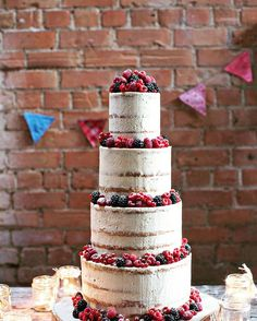 The popular semi-naked #wedding #cake with homemade buttercream and fresh summer berries. Available @donnybrook_fair Call into the #malahide store for a consultation and complimentary cake tasting. Styled by Orla @cornershopproductions and photography @jomurphyphotographer