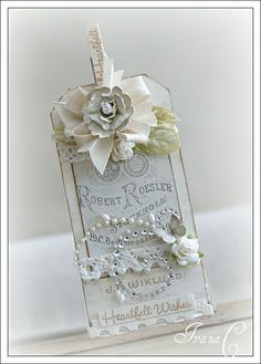 shabby chic tag, to me this would be cute without the bling, without the flower and without the lace, thats my style