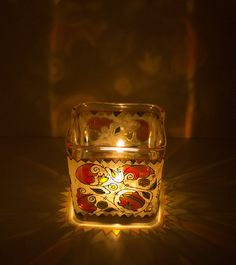 painted glass candleholder in orange and white on Etsy, $35.00