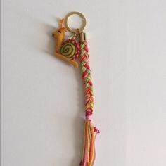 Cute Hand Made Yellow Snail Key Chain *Hand made artisan key chain from Chiapas, Mexico.                                                                      *Every key chain is unique.                                        *Great for yourself or as a gift.                                 *Looks so cute on bags and backpacks!                *Price is FIRM! La New Yorkilla Accessories Key & Card Holders