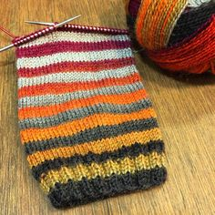The yarn is Crazy Zauberball knitted 4 rows at a time with both ends of the ball.  So stripes!