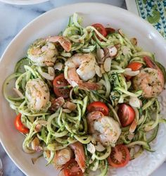 Low Carb Zucchini Noodles with Shrimp. - This vegetable pasta is tossed with a bright lemon basil dressing and succulent grilled shrimp.