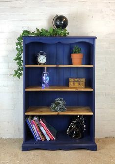 This bookcase has been painted in Annie Sloan's Napoleonic blue, and then layered with lashings of clear and dark wax. The adjustable shelves have been sanded and dark waxed, for a real rustic look. Shop our full collection of Storage here at Vinterior Blue Bookshelves, Pine Bookcase, Painted Bookshelves, Wooden Bookcase, Paint Bookshelf, Bookcase Makeover, Furniture Makeover, Diy Furniture, Furniture Design
