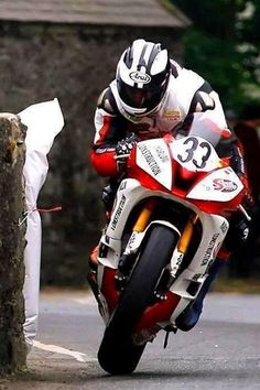 Michael Dunlop at over riding a wheelie whilst hanging off the side of hi.- Michael Dunlop at over riding a wheelie whilst hanging off the side of his bike only a foot from a stone wall. Racing Motorcycles, Motorcycle Bike, Velentino Rossi, Course Moto, Gp Moto, Isle Of Man, Super Bikes, Street Bikes, Road Racing