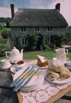 View of a delicious cream tea laid out on the picnic table in front of the Branscombe Tearooms, Devon.