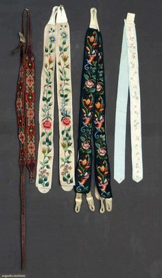 2 pair 1845-1860: 1 white silk, probably wedding, w/ floral embroidery; 1 black w/ cross-stitch wool floral embroidery; 2 pair 1880-1890: 1 ...