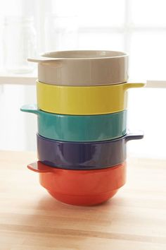 Brightly colored bowls you can stack.  (Home Decor on a Budget)