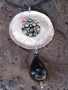 silver tray and vintage earring ...Pendant with an onxy teardrop,