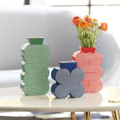 The primary Pompidou vases pair patterns with bold color for added ooomph. A high-gloss finish adds to their power-pop glory.