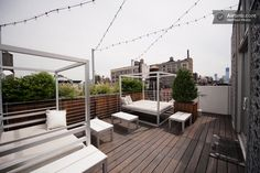 Outdoor patio beds and twinkle lights = a peaceful little getaway.