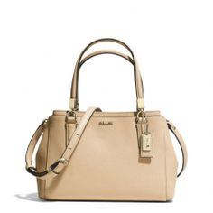 The Madison Mini Christie Carryall In Saffiano Leather from Coach  Tan or pink? This purse is just right! I had to part with every large purse due to my injury. :( Small purses can be cool too...