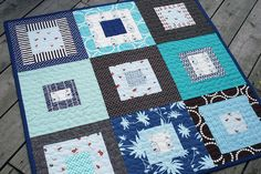 Love the simplicity of this squares-within-squares Goldfish Quilt by Fresh Lemons