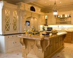 Pretty antique oak island with creamy white cabinets